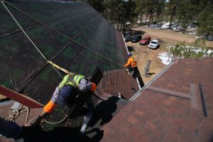 Roofers are prepping a roof for new a shingle installation