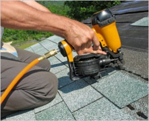 roof system being installed by nail gun
