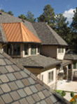 Metal roof and composition shingles