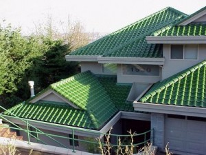 A green clay tile roof on a home.