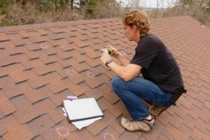 Integrity Roofing Completing a Free Roof Inspection