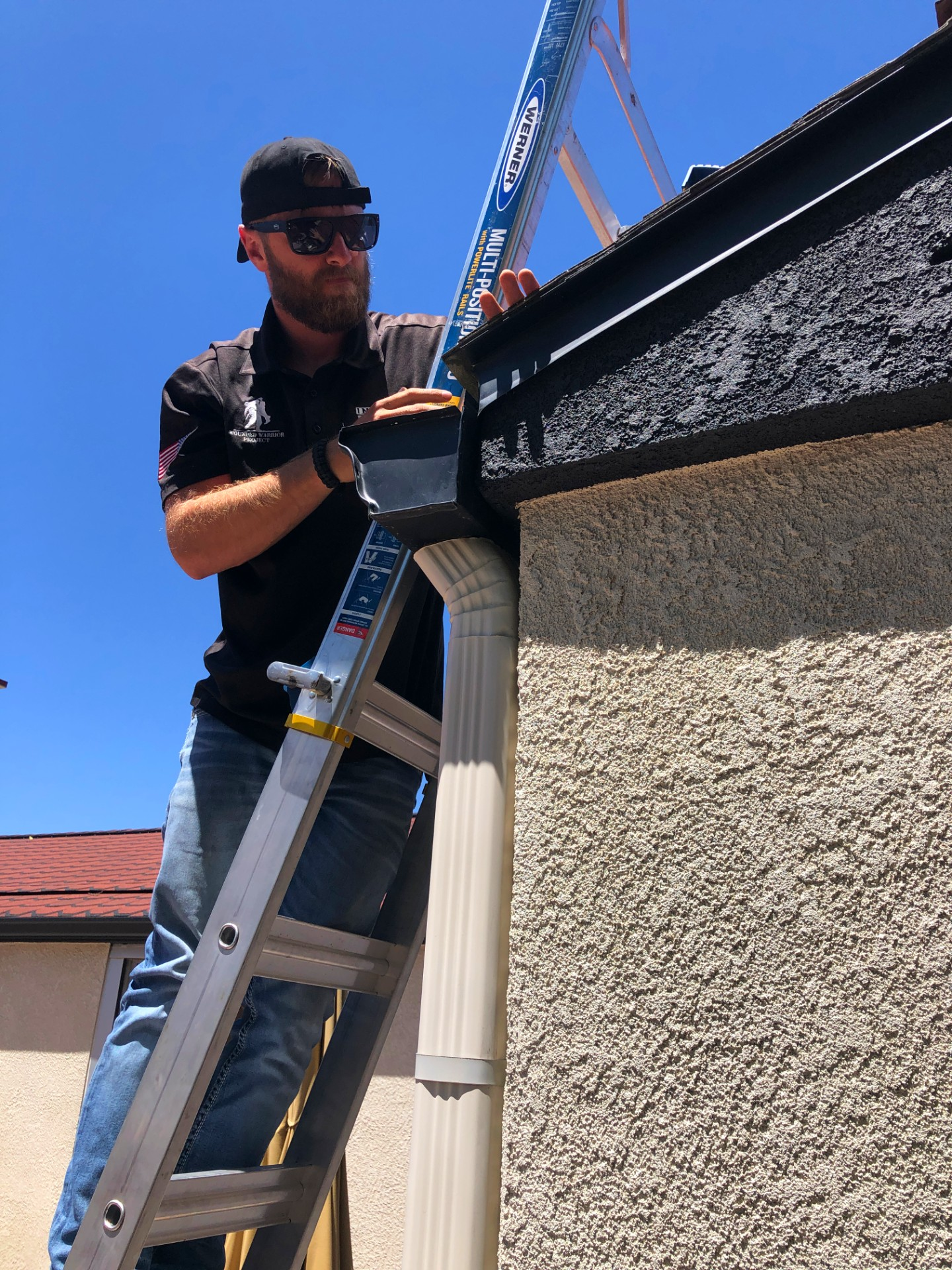 Inspecting roof on ladder